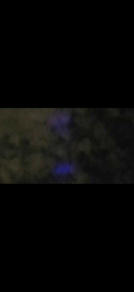 Heldere blauwe straal bewoog te snel foto