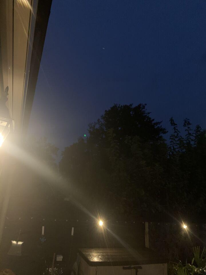 Groen licht dat zich verplaatste en eventjes rond hing foto