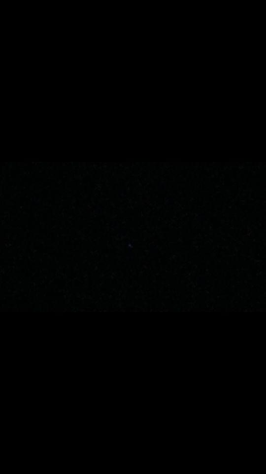 Stilstaand lichtpunt wat van kleur veranderde foto